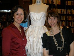 Mireya and Leanne, next to the Project Runway winning designer's wedding dress in hemp silk